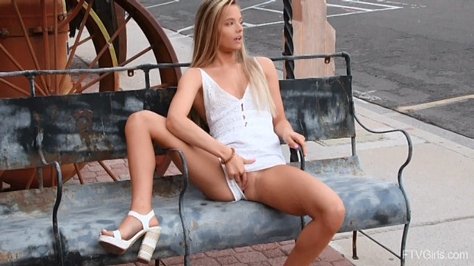 Unashamed young blonde shows her tits & pussy in public